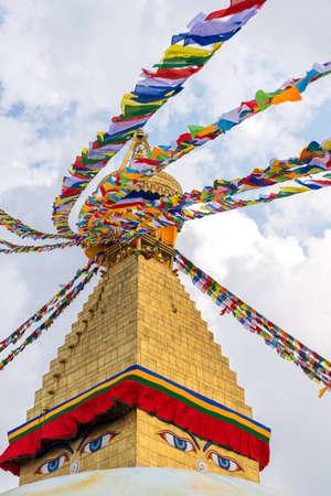 Boudhanath Stupa and prayer flags in Kathmandu, Nepal. Buddhist stupa of Boudha Stupa is one of the largest stupas in the world Stock Photo