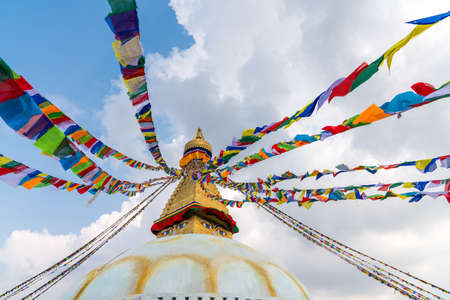 Boudhanath Stupa and prayer flags in Kathmandu, Nepal. Buddhist stupa of Boudha Stupa is one of the largest stupas in the world Фото со стока