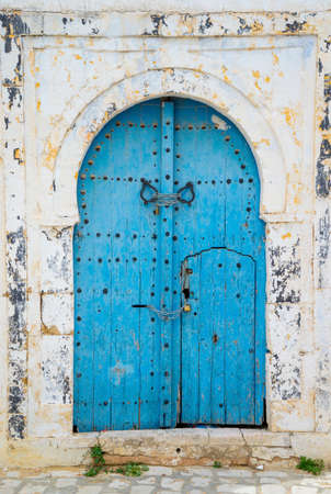 Aged Blue door in Andalusian style from Sidi Bou Said in Tunisia