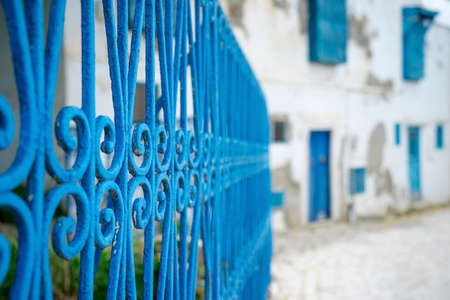 Aged Blue doors and windows in Andalusian style from Sidi Bou Said in Tunisia Stock fotó