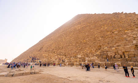 People taking photos and selfies near Pyramids of Giza in Cairo. Captured in Egypt. Autumn 2018