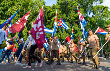 People marching with flags during May day parade or International Workers Day, Havana, Cuba, spring 2018