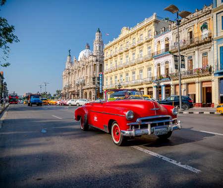 Retro car as taxi with tourists in Havana, Cuba. Captured near Gran Teatro de La Habana, El Capitolio and Paseo del Prado in spring 2019