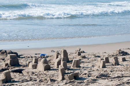 Destroyed Sand Castle on a Sunny Beach