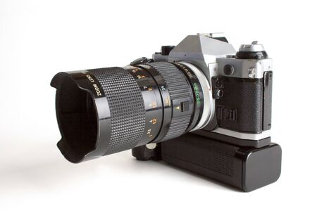 winder: film camera with zoom lens and  motor winder , white backround Stock Photo