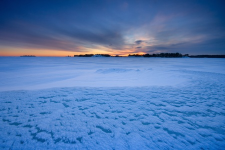 disperse: Sunset and icy snow Stock Photo
