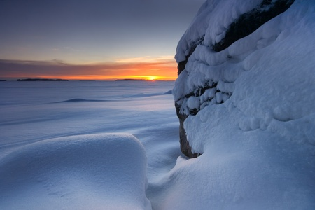 Snowy beach rocks photo
