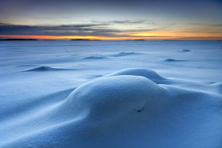 Snowy seascape in early morning dawn photo
