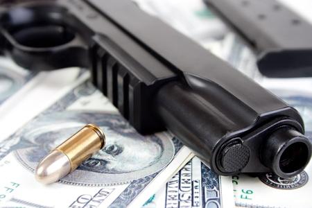 9mm bullet and handgun with money photo