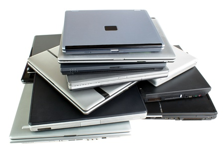 Stack of used laptop computers, isolated on white Stock Photo