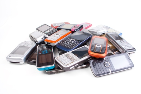 Stack of cell phones, isolated on white photo