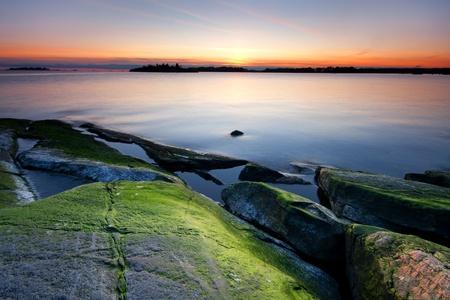 alga: Colorful beach rocks and sunset