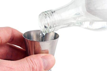 oz: Pouring vodka into measuring cup Stock Photo