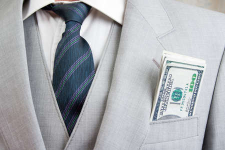 Man with a suit and money in pocket photo