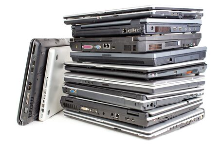 old pc: Pile uf used laptops, white background Stock Photo