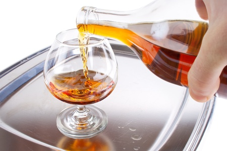 sniffer: Pouring cognac into the sniffer on the serving tray