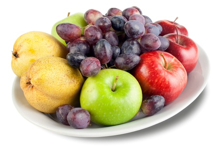 mixed fruits: Apples, pears and grapes on the plate Stock Photo