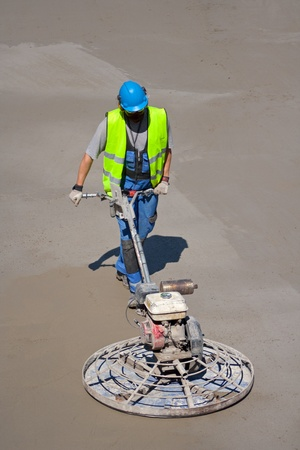 Trowel machine in use in the construction site photo