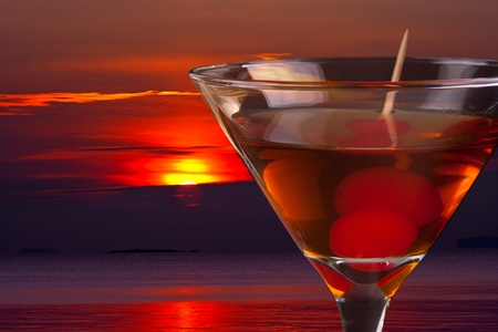 Cocktail and sunset Stock Photo