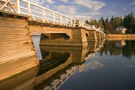 windless: Photo from wooden bridge in warm evening light Stock Photo