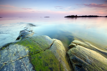 Late evening seascape in nature park, Finland photo