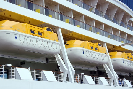 lifeboats: Lifeboats on big cruise liner Stock Photo
