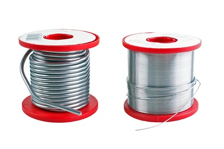Two different size soldering tin spools