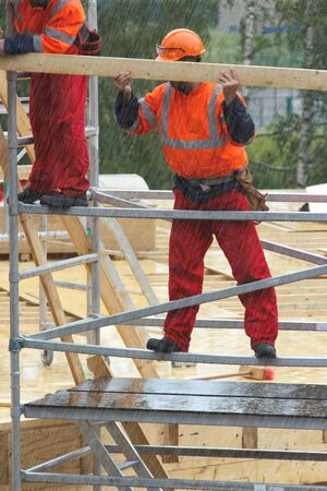 construction platform: Construction workers is rainy day