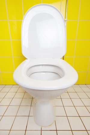 Ceramic toilet closeup, front view, seat left down Stock Photo - 15789400