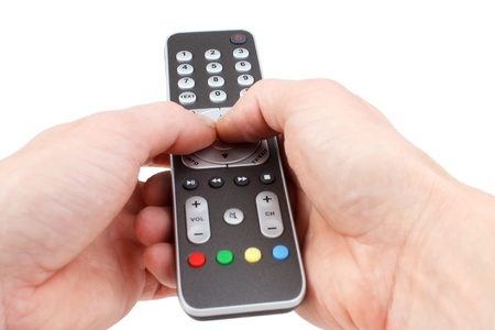 Pushing buttons of remote controller, isolated photo