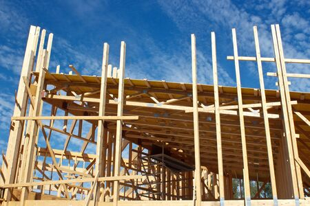 timber frame: Timber studs and roof work in house frame Stock Photo