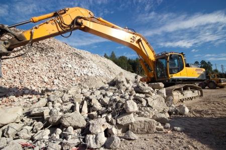 Construction demolition waste and excavator