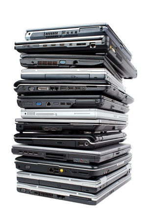 Pile of used laptops for recycling, isolated on white