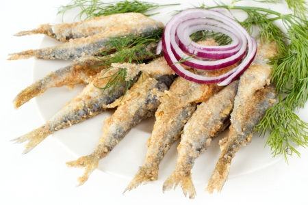 breaded: Roasted and breaded vendace fish on dish