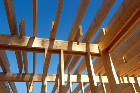 Wooden house roof skeleton closeup photo