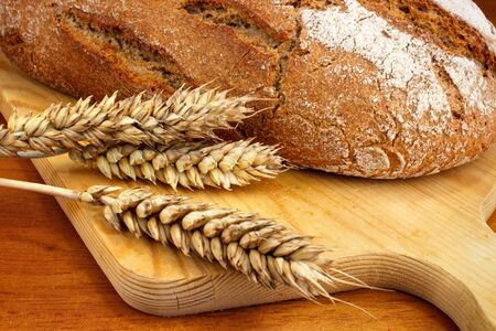 gluten: Fresh baked loaf with wheat ears Stock Photo
