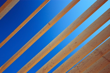 rafter: Roof rafter timbers against blue sky Stock Photo
