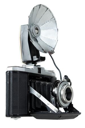 folding camera: Vintage folding camera with bulb flash, isolated