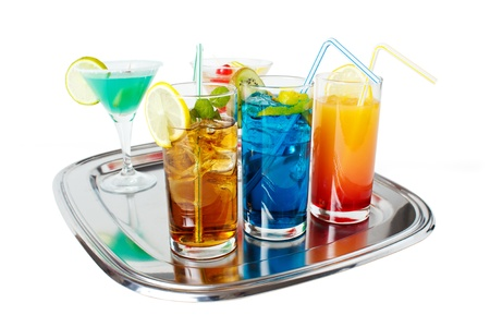 Different alcoholic beverages on tray , isolated