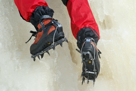 crampons: Ice climbing crampons in use closeup