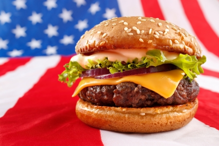 Juicy grilled hamburger on USA flag background photo