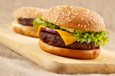 Homemade grilled hamburgers on wooden board photo