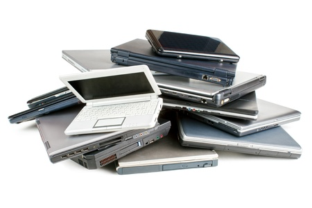 Stack of different sized and aged laptops