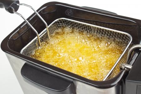Cooking fries in deep fryer Standard-Bild