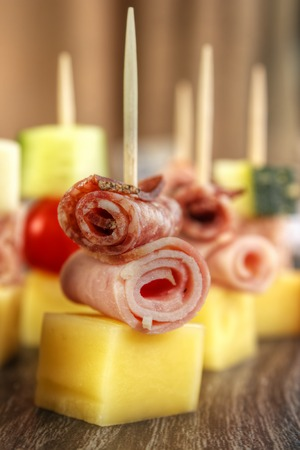 nibbles: Party nibbles on cocktail sticks ,  vertical Stock Photo