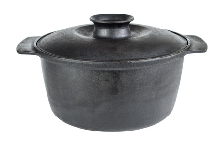 Old cast iron cooking pot , isolated on white Stock Photo