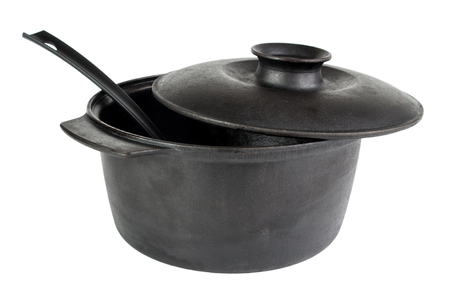 cast iron: Old cast iron cauldron with scoop , isolated