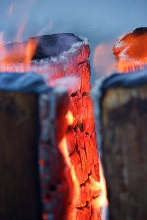 embers: Logs in fire with burning red wood , vertical
