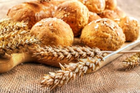 Fresh homemade buns with wheat ears Standard-Bild