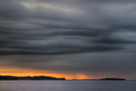 natural  moody: Coming storm in the coast of Helsinki with sunset